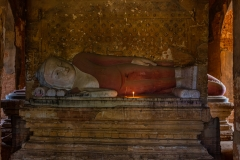 lying ancient buddha statue